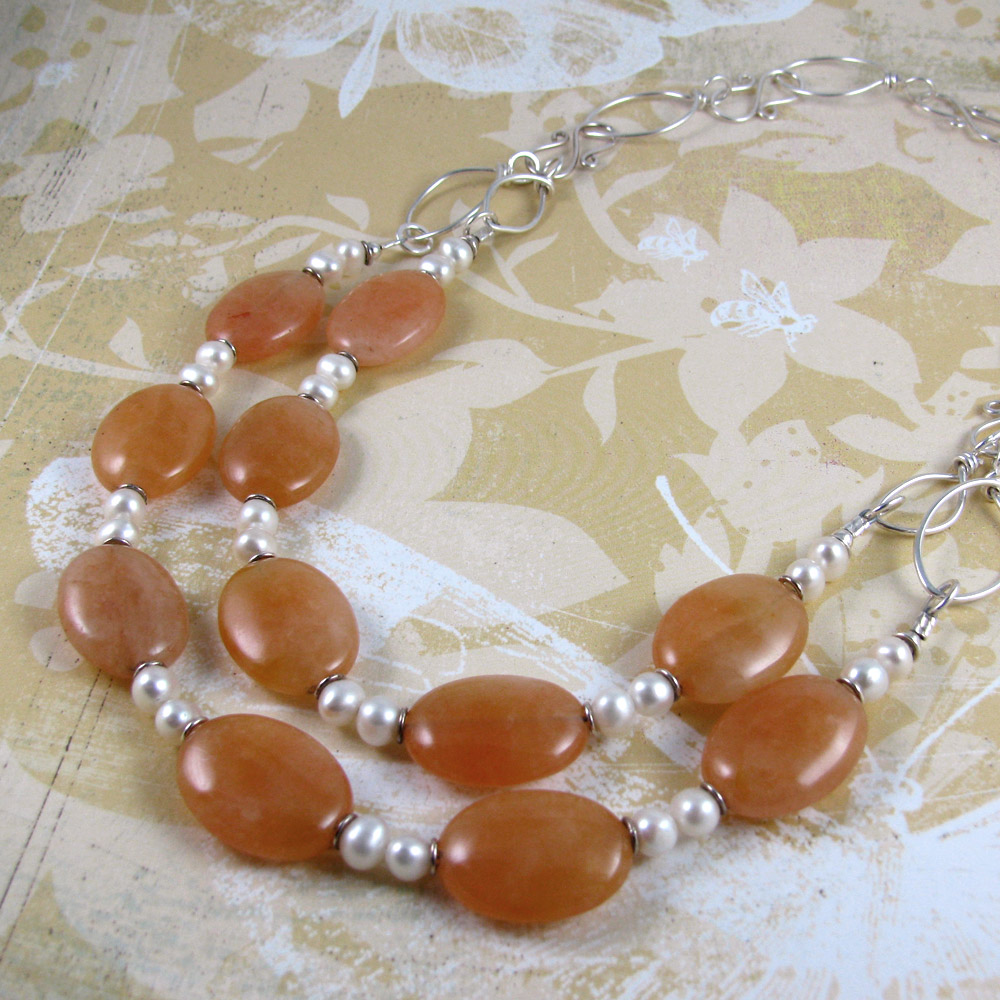 PEACH FANTASY peach jade gemstone ovals and freshwater pearls with handworked sterling silver leaves